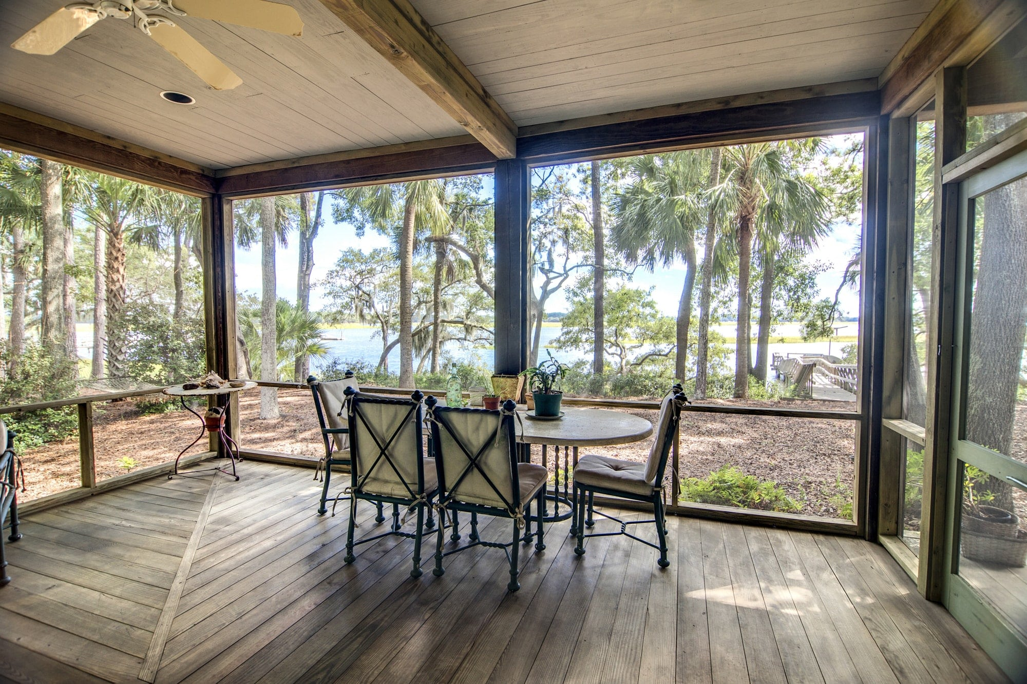 rustic porch with forest and waterfront view