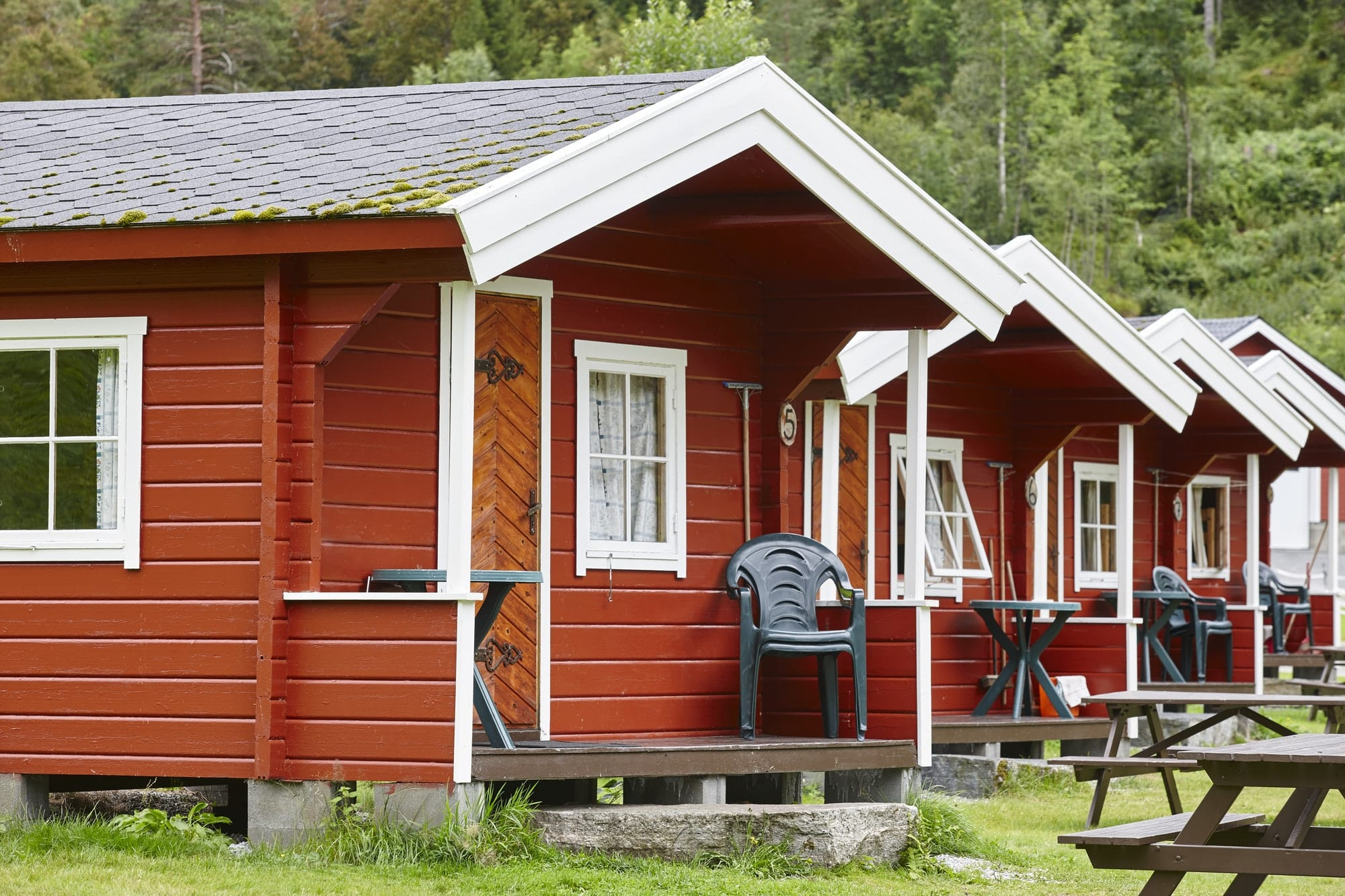 Traditional norwegian red wooden cabins facades. Travel Norway